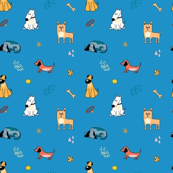Vector pattern with cute different breeds of dogs in cartoon style on a blue background
