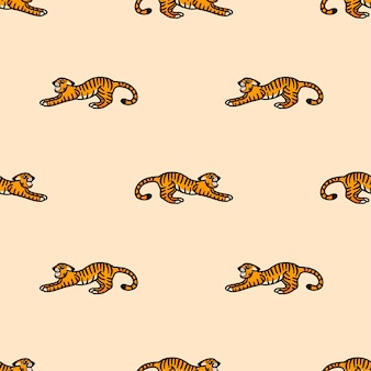 Vector pattern with a snarling tiger in cartoon style on a beige background
