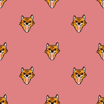 Vector pattern with a snarling tiger face in cartoon style on a pink background