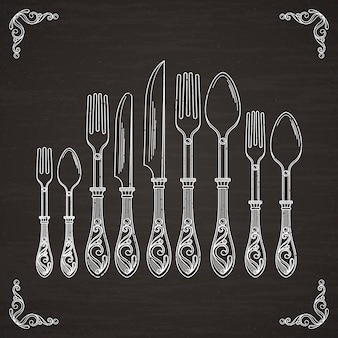 Vector pictures of spoon, fork and knife. tableware hand drawing silhouette on black chalkboard
