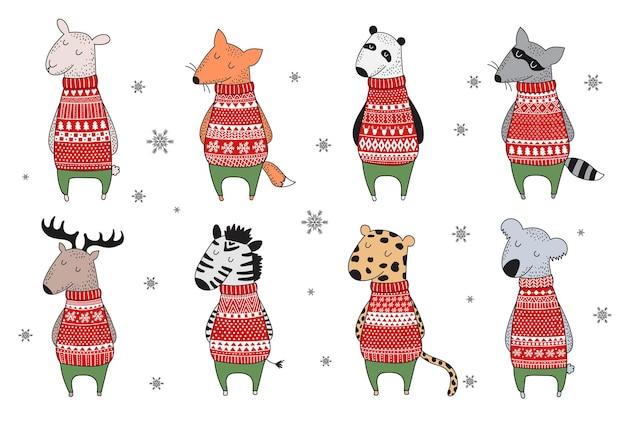 아늑한 스웨터에 귀여운 겨울 동물이 있는 벡터 엽서