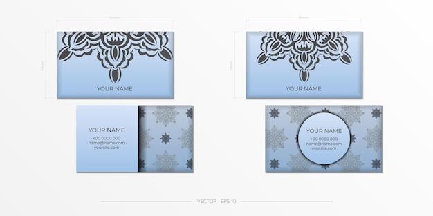 豪華な黒い装飾品が付いている青い色の名刺のベクトルの準備。ヴィンテージパターンの名刺デザイン印刷可能なテンプレート。