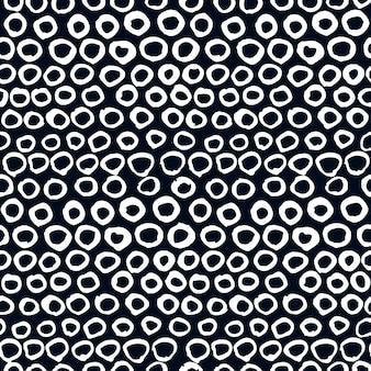 벡터 원활한 예술적 패턴입니다. 손으로 그린 낙서 점, 검은 배경에 흰색 원. 디자인, 카드, 패브릭, 장식 등에 사용하십시오.