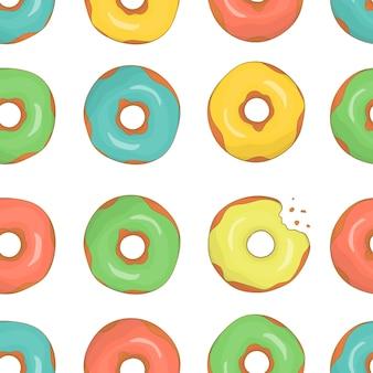 カラフルなドーナツのシームレスなパターンベクトル