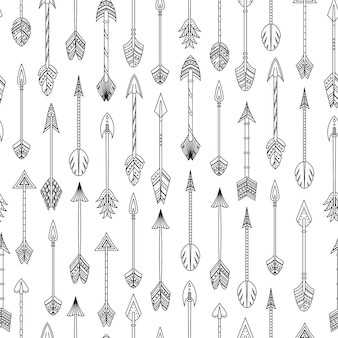 Vector seamless pattern with boho arrows in outlines.