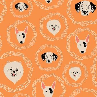 ブルテリアダルメシアンポメラニアンとオレンジ色の背景の葉とシームレスなパターンをベクトルします。