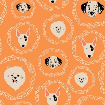 Vector seamless pattern with bullterrier dalmatian pomeranian and leaves on orange background