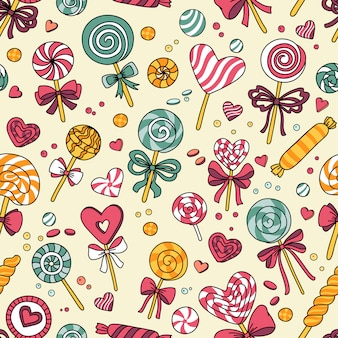 Vector seamless pattern with candy and lollipops