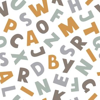 Бесшовный узор вектор с красочным английским алфавитом в плоский на белом фоне Premium векторы