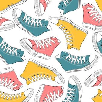 Бесшовный узор вектор с красочными кроссовками
