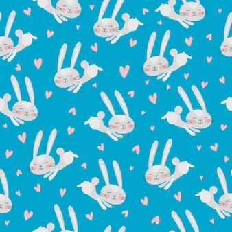 青い背景の上のかわいいウサギの心とシームレスなパターンをベクトルします。