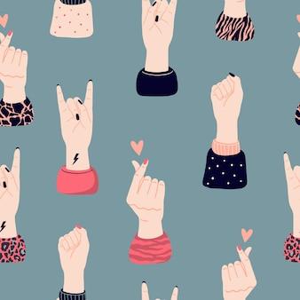 女の子の手とさまざまなジェスチャーでシームレスなパターンをベクトルします。少女の力とフェミニズムの概念。国際女性の日、少女の抗議