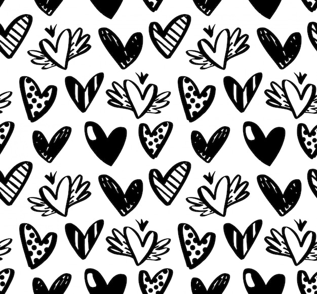 Vector seamless pattern with hand drawn hearts isolated on white background.