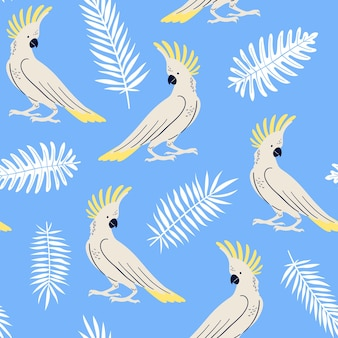 Vector seamless pattern with tropical leaves and parrots umbrella cockatoo summer illustration