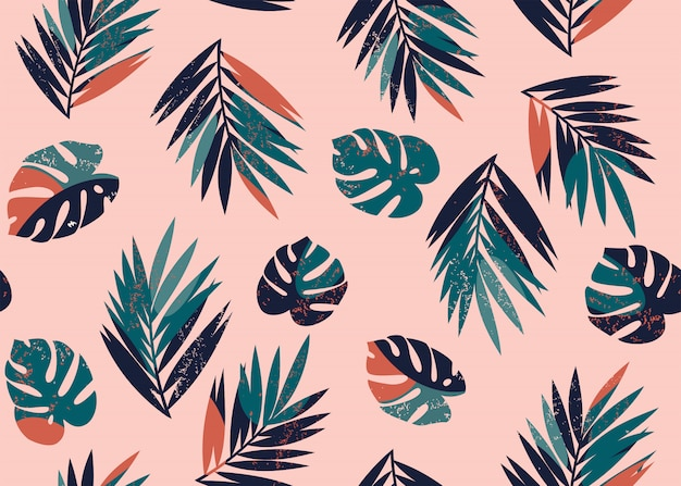 Vector seamless tropical pattern with monstera and palm leaves Premium Vector