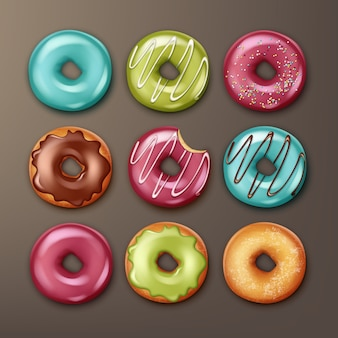 Vector set of different donuts with pink, blue, green, brown icing, white stripes and sprinkles top view isolated on background