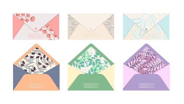 メールの封筒のベクトルを設定は、孤立した白地に花柄の美しいプリントが付いている手紙のはがきを争う