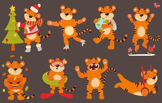 Векторный набор тигрят в разных позах. тигры с глобусом, тыквой, на роликах, с елкой.
