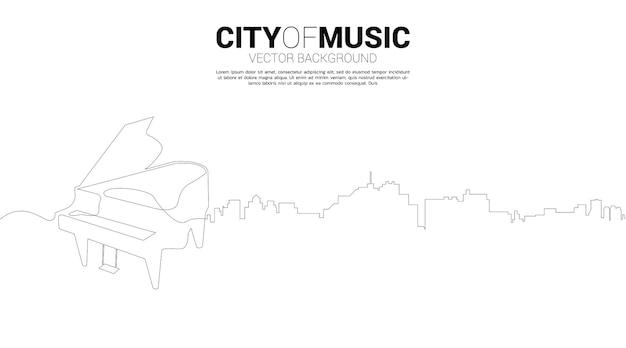 Векторный силуэт фортепиано с городом из одной линии. концепция города классической музыки.