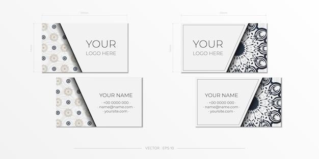 명함의 디자인을 인쇄하기 위한 벡터 템플릿 블랙 빈티지 장식으로 흰색 색상입니다. 그리스 패턴의 명함 준비.