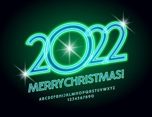 ベクトルトレンディなグリーティングカードメリークリスマス2022年グリーンネオンアルファベット文字と数字のセット