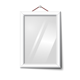 Vector white isolated vertical photo frame hanging on the white wall