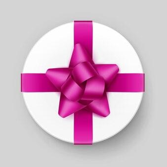 Вектор белая круглая подарочная коробка с блестящим пурпурным темно-розовым бантом и лентой