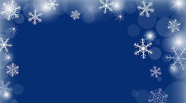 青い背景と星と雪片のクリスマスと新年の背景とベクトルの冬のバナー