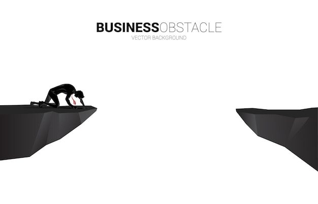 Vector3693silhouette of businessman crawling on the cliff. concept for dead end business and obstacle.