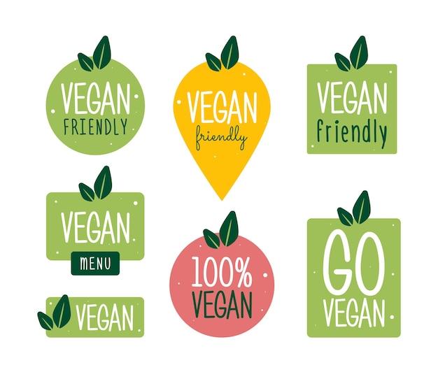 채식주의 아이콘 세트입니다. 바이오, 생태, 유기농 로고 및 배지, 라벨, 태그. 흰색 바탕에 녹색 잎입니다. 벡터 일러스트 레이 션