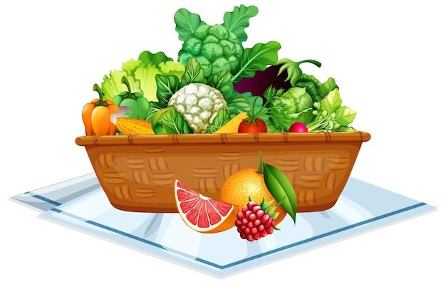 白い背景で隔離のバスケットの野菜や果物