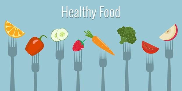 Овощи и фрукты на вилках. здоровая пища