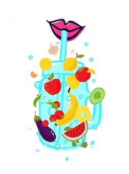 Vegetables and fruits in a transparent glass for a smoothie with a straw.