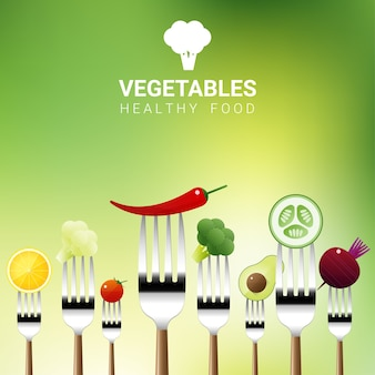 Vegetables on forks isolated on natural background