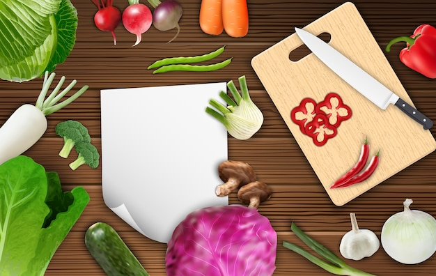 Vegetables on the table with paper and cutting board