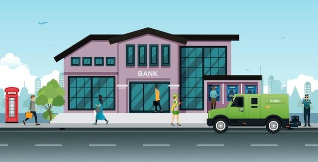 도시를 배경으로 은행 앞에 주차된 차량