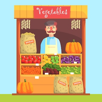 Vendor behind market counter with assortment of vegetables