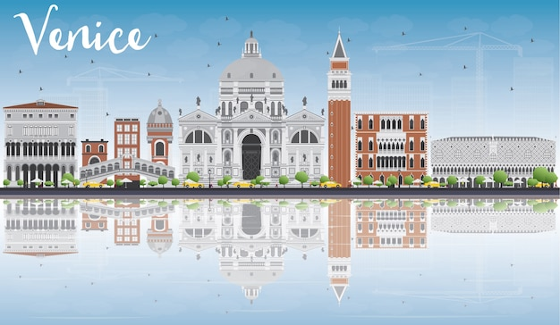 灰色と赤の建物とヴェネツィアのスカイラインのシルエット。