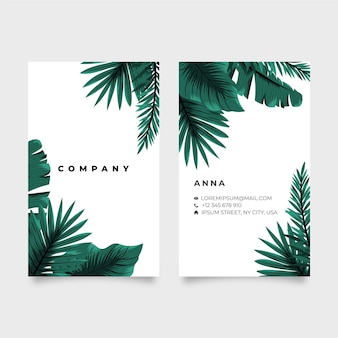 Vertical double-sided business card with tropical leaves
