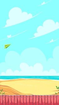 Вертикальное игровое поле зеленый бумажный самолетик, летящий в облаках над песчаным берегом моря с красным деревянным забором