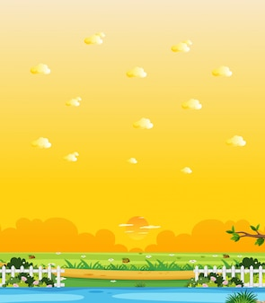 Vertical nature scene or landscape countryside with forest riverside view and yellow sunset sky view
