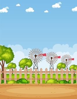 垂直の自然シーンや風力タービンと昼間の空白の空のある田園風景