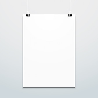 Vertical poster suspended on office clips mockup