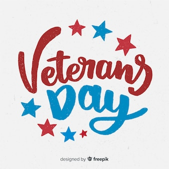 Veterans day background with red and blue lettering