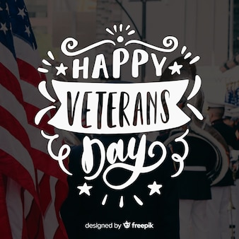 Veterans day lettering with stars and ribbons