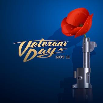 退役軍人の日。古い米国のライフルの銃身に挿入された赤いポピー