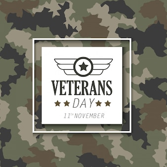 Veterans day with emblem over military cloth background