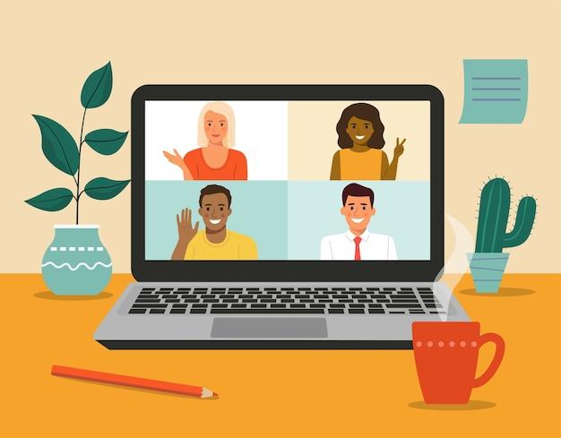 さまざまな人々のビデオ会議。机の上のラップトップ。