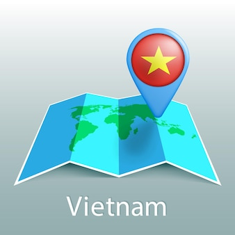 Карта мира флаг вьетнама в булавке с названием страны на сером фоне