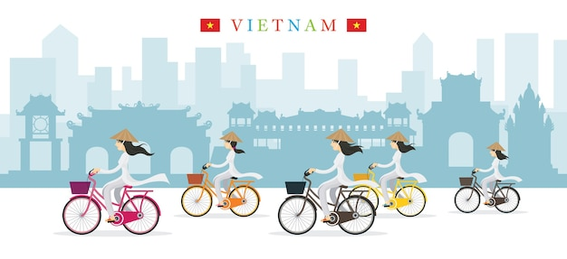 Vietnamese women with conical hat ride bicycles landmarks